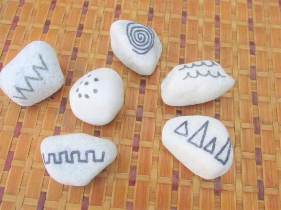 This image has an empty alt attribute; its file name is 41-mark-making-stones.jpg