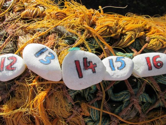 Number stones with teen numbers painted onto them