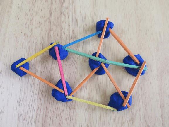 Craft sticks and playdough activity for fine motor